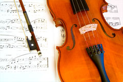 Violin and a Bow. This is a close-up of a violin and a bow on a music sheet Stock Images