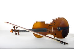 Violin And Bow. Classical violin or fiddle and bow on its side Royalty Free Stock Image