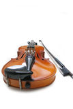 Violin and bow. Isolated violin and bow Royalty Free Stock Photography