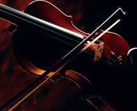 Violin and bow. Closeup of a classical violin and bow viewed the chiaroscuro style Stock Images