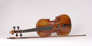 Violin with Bow_8190-1S. Antique Violin Standing on its' Side with Bow Royalty Free Stock Photo