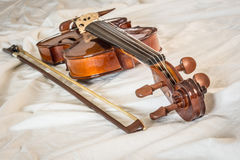 Violin and bow on cloth Stock Photography
