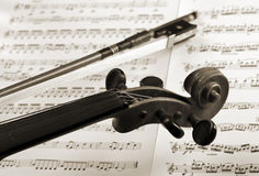 Violin and bow detail on notation sheets Royalty Free Stock Photography