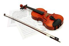 Violin with bow on music books Royalty Free Stock Photography