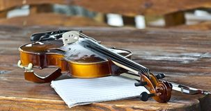 Violin bow notes. On a wooden table Royalty Free Stock Image