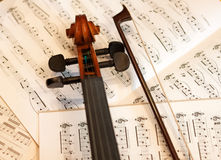 Violin bow and notes Royalty Free Stock Photography