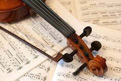 Violin bow and notes Royalty Free Stock Images