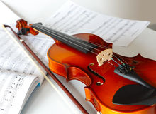 Violin. Bow and notes on the table Stock Photo