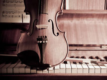 Violin and bow on Piano with sheet music Stock Image