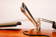 Violin bow on the string. A fiddlestick (violin bow) on the violin string during playing Stock Images