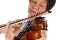 Violin bow and Strings touching perfectly by its master senior p Stock Images