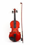 Violin with bow upright on whi. Te background, front view, portrait orientation Stock Image