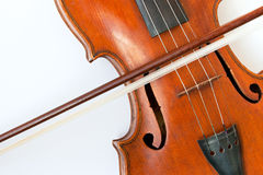 Violin with a bow on a white background Stock Photography
