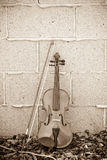 Violin on Brick Wall Royalty Free Stock Photography