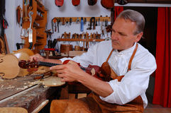 Violin builder and his workshop Stock Photography