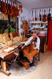 Violin builder and his workshop royalty free stock images