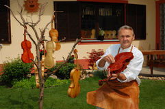 Violin builder and his workshop royalty free stock photos