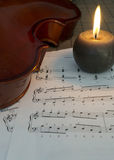 Violin, candles and notes Stock Image