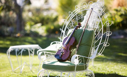 Violin on a Chair. A Violin Set On a Chair Outdoors Stock Photos