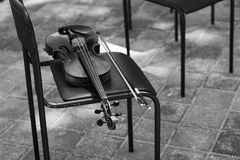 Violin is in the chair. Stock Photography