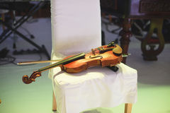 Violin on Chair Royalty Free Stock Image