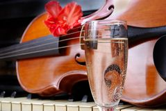Violin and champagne. violin and piano. after the concert. stock photo