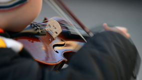 Violin, child playing the violin stock footage