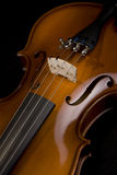 Violin Close. This beautiful violin has been captured as a gorgeous symbol of symphony and music.  The shot is close to better show the craftsmanship of this Stock Image