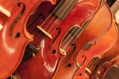 Detail from violin. Violin close up detail with wooden body and strings royalty free stock images