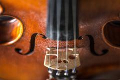 Violin. Closeup of a classical violin with both F Holes in focus Stock Photography