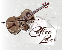 Violin and a coffee of cup for a coffee lover. Royalty Free Stock Photography