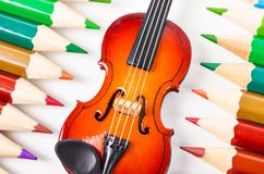 Music and art concept. Violin and color pencil on white background. Music and art concept Stock Photo