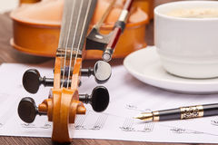 Violin and cup of coffee. Royalty Free Stock Images