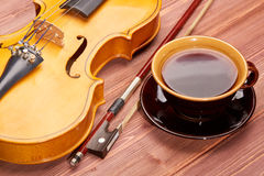 Violin and cup of coffee. Stock Image
