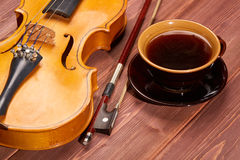 Violin and cup of coffee. Royalty Free Stock Photos