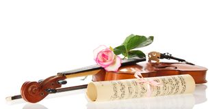The violin, curtailed notes and rose Stock Photos