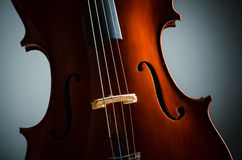 Violin in dark room Royalty Free Stock Photo