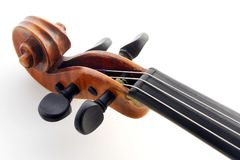 Violin detail. Close macro shot of pegs and scroll. Authentique italian beautiful violin Stock Photos