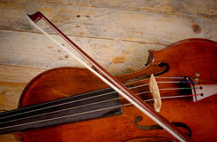 Violin detail. Old violin and arch on a wooden background Stock Images