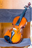 Violin in Director's Chair Royalty Free Stock Image