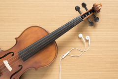 violin and earphone Royalty Free Stock Photos