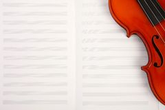 Violin on empty music book Royalty Free Stock Image