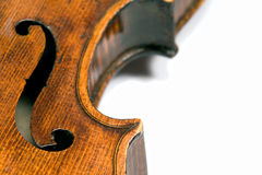 Violin f-hole. Closeup profile of side (ribs) of a beautiful 19th century violin (Pietro Floriani). Shot under studio lighting against white background Stock Photos