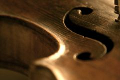 Violin f scroll detail. Wood detail, violin instrument. An XVIII century violin Royalty Free Stock Images