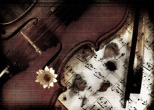 Violin with music on grunge Stock Photo