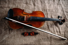 Violin, fiddlestick and bowtie, canvas background Stock Photos