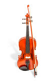 Violin and fiddlestick. Brown classical violin and fiddlestick standing vertically front view isolated on white background Stock Photography