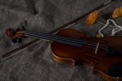 Violin, fiddlestick and bowtie, canvas background royalty free stock image