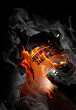 Violin in fire Stock Image