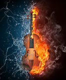 Violin on Fire and Water. Violin in Fire and Water Isolated on Black Background Royalty Free Stock Images